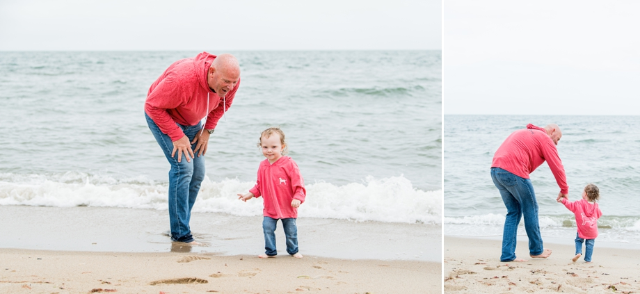 Grandfather playing on beach with grandson
