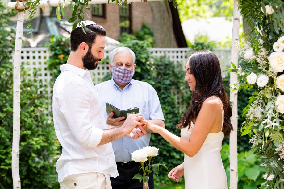 putting on rings at wedding ceremony