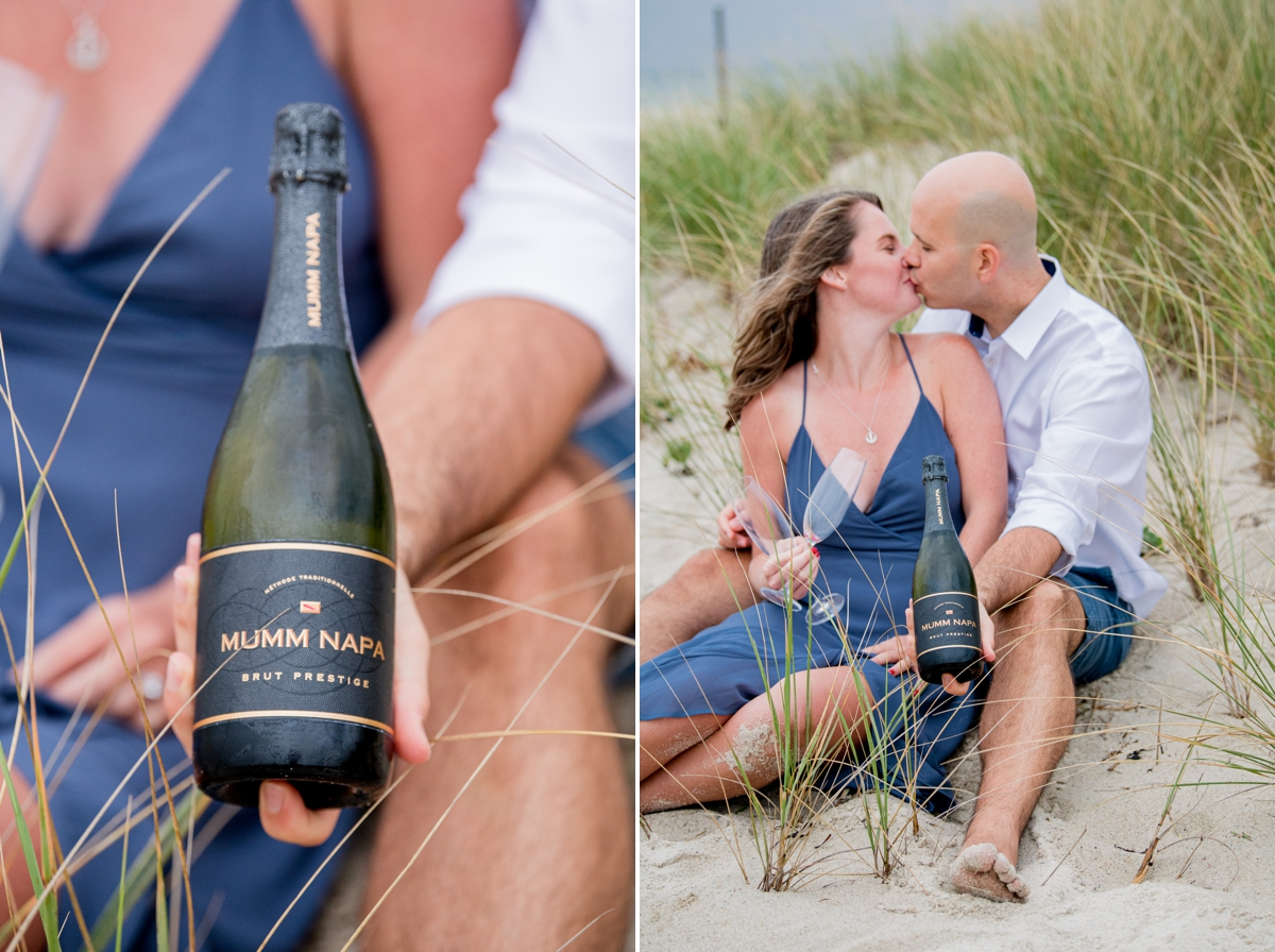Engaged couple having champagne on Ridgevale Beach and kissing