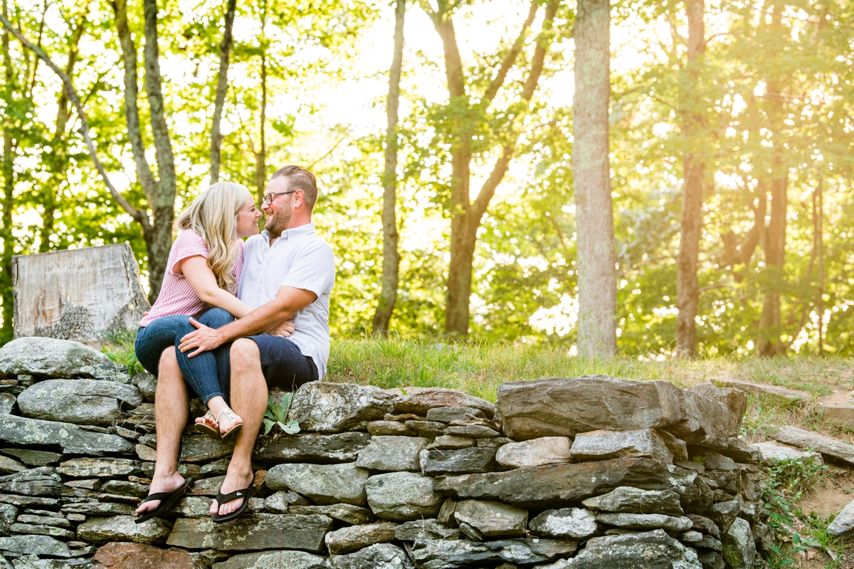 kissing on rock wall at Moore State Park