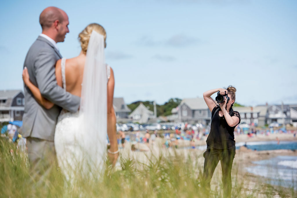 Photographer taking a photo of a newly married couple I Questions to Ask Your Wedding Photographer Blog