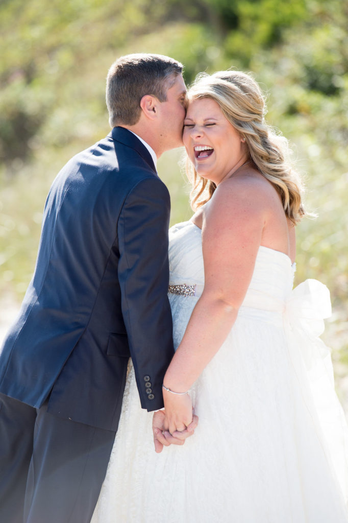 Groom kissing smiling bride on the cheek on a beach on Cape Cod  I Alicia Petitti Photography