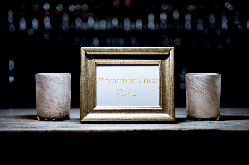 Hashtag sign next to two vases I How to Create a Wedding Hashtag