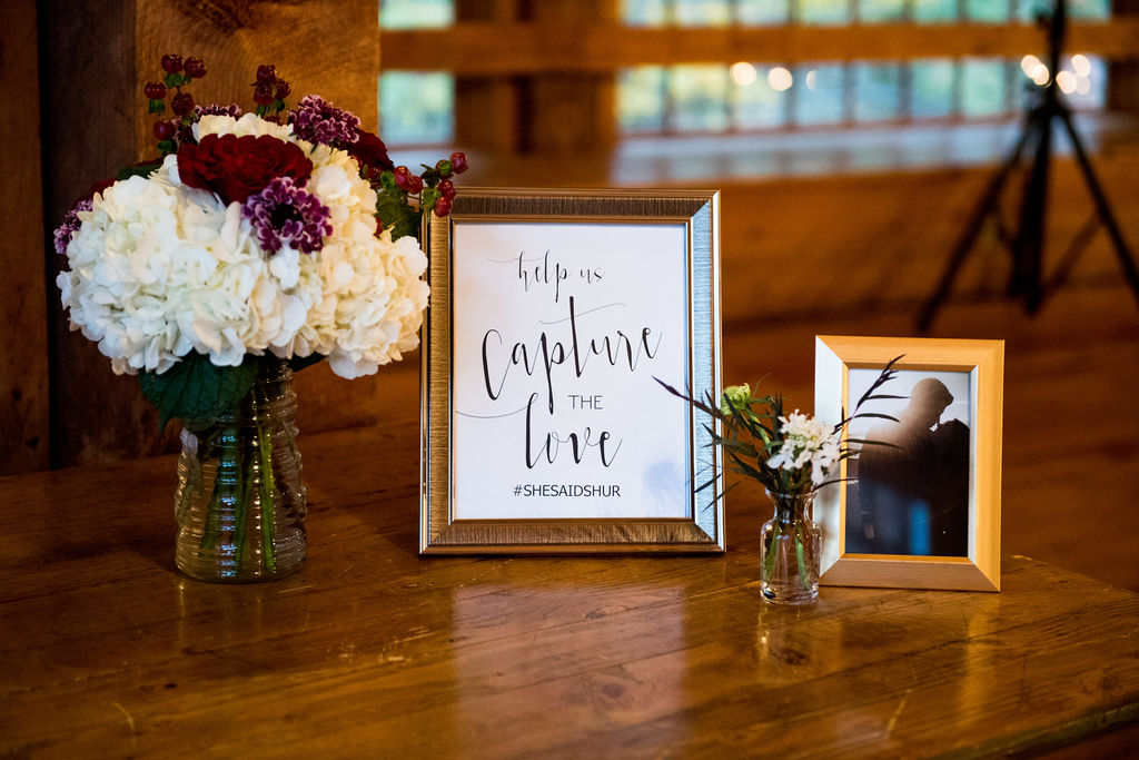 Table with hashtag sign & bouquet I How to Create a Wedding Hashtag